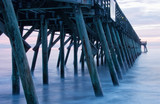 Long Camera Exposure of Pier During Sunrise in Myrtle Beach - 220695588