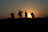 Silhouette of two samurais in duel. Picture with two samurais and sunset sky. Selective focus