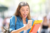 Excited student receiving good online news - 220700525