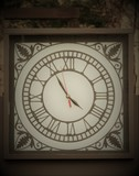 clock with hour marker in Roman numerals - 220701325