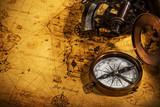 Old vintage navigation equipment on old world map. - 220703946
