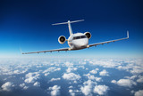 Luxury private jetliner flying above clouds - 220703990