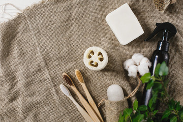 sustainable lifestyle concept. eco natural bamboo toothbrush, crystal deodorant,luffa, coconut soap,cotton. zero waste flat lay. bathroom essentials, plastic free items © sonyachny