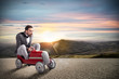 Leinwandbild Motiv Businessman runs with his car on the road