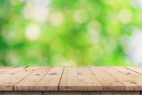 Empty wooden table top and green bokeh display montage for product with space. - 220747766