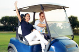 Couple in driving buggy on golf course - 220747768