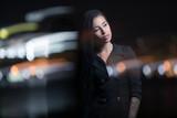 Stylish woman at night, city lights background - 220748532