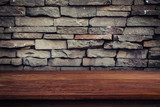 Empty wood table and grunge brick wall and display montage for product. - 220748923