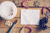 Top view coffee cup and pen, blank paper on wood with christmas decoration for New year concept. - 220749100