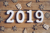 New year 2019 word and Christmas decoration on wooden table. New Year concept. - 220749196