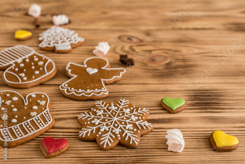 Poster Christmas homemade gingerbread cookies on wooden table