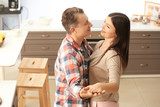 Lovely couple dancing together in kitchen - 220752109