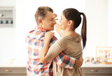 Lovely couple dancing together in kitchen - 220752118