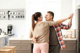 Lovely couple dancing together in kitchen - 220752120