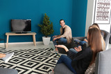 Young people watching movie in home cinema - 220752137