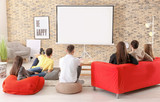 Young people watching movie in home cinema - 220752141