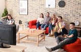 Young people watching movie in home cinema - 220752150