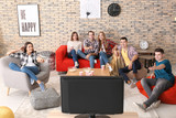 Young people watching movie in home cinema - 220752152