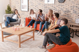 Young people watching and discussing movie in home cinema - 220752169