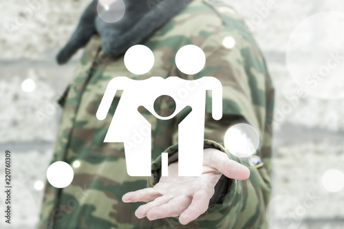 Military soldier offers a family people icon on a virtual interface. Military humans protection concept. Protection of civilians. Army task and mission.
