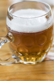 The foam fell in a glass of beer. - 220762994