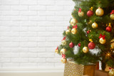 abstract background from christmas tree and blank brick wall, classic white interior backdrop, copy space for text, winter holiday concept - 220764727