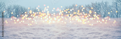 Leinwanddruck Bild Magic winter landscape with snow and golden bokeh lights  -  Banner, Panorama, Background