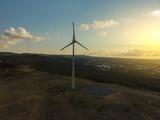 Wind turbine and sunset aerial image - 220778109