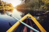 First person view kayaking through clear river - 220778365