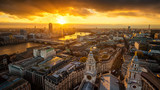 London, England - Aerial panoramic skyline view of London taken from top of St.Paul's Cathedral at sunset with River Thames, beautiful golden sky and clouds - 220783704