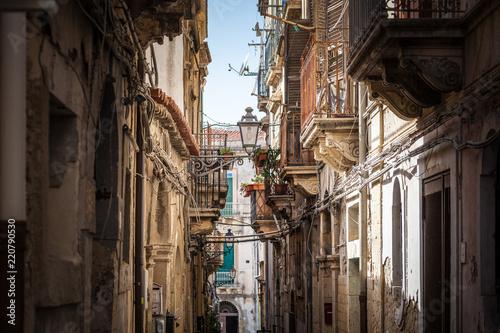 Fototapeta View of narrow street in Syracuse, Italy, Sicily island