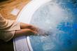 Leinwanddruck Bild - Woman entering jacuzzi in spa resost