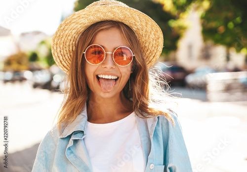 Portrait Of Beautiful Cute Blond Teenager Model In Summer Hipster Clothes Posing On The Street Background