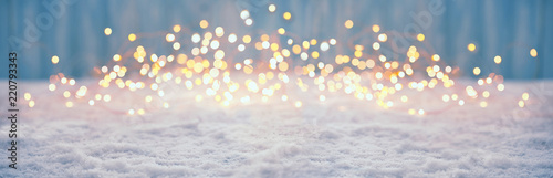 Leinwanddruck Bild Abstract magic winter landscape with snow and golden bokeh lights - Banner, Panorama