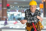 Male worker with tool belt isolated on   background