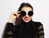 Young funny brunette  woman in big sunglasses. Fashion concept.  - 220796715
