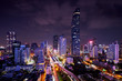 Leinwanddruck Bild - night of urban cityscape in metropolis and light of sky train