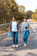 couple with backpacks holding hands while traveling together
