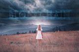 Blonde woman stands on countryside field with futuristic blockchain cyberspace network background. - 220826559