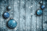 Textured soft blue colored wooden boards with illustrated snowflakes and Christmas bulbs set with place for message. Greeting card background.  - 220826596