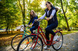 Leinwanddruck Bild - Healthy lifestyle - people riding bicycles in city park