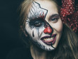 Halloween, the face of a girl is a doll, the floor of a face is dead. A woman with a horrible make-up.