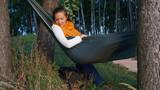 Woman resting in a hammock - 220838587