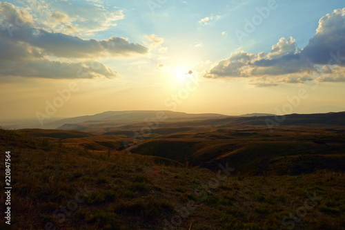 Landscape during sunset in Geghama mountains, Armenia - 220847564