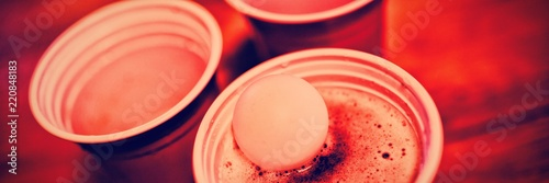 Close-up of pong ball on beer glass