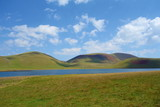 Lake Akna surrounded by Geghama mountains on a hiking trail leading from Azhdahak volcano in Armenia - 220848571