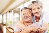 Happy senior couple smiling on background - 220854944