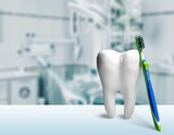 Big tooth model and toothbrush on light background - 220858333