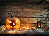 Halloween Pumpkins In Rustic Background With Lantern  - 220858569