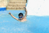 Boy jumping in the water - 220860363
